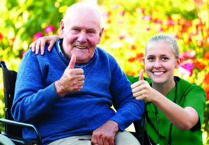 carer with man thumbs up xl Green 300x208 - Care Homes Dorset & Residential Care Wiltshire