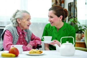 carer with teacup xxl Green 300x200 - Care Homes Dorset & Residential Care Wiltshire